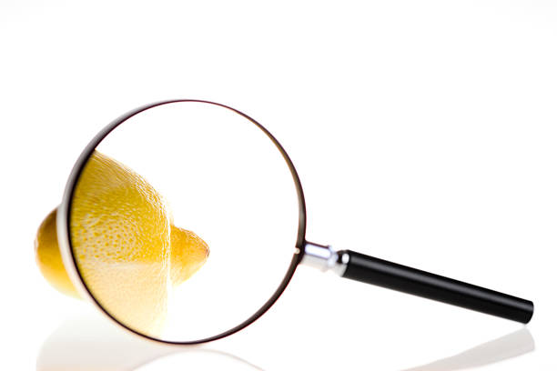 Lemon under magnifying glass  aggrandize stock pictures, royalty-free photos & images
