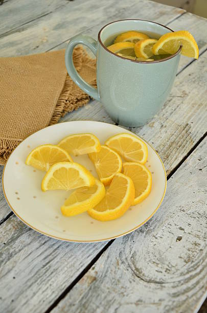 Lemon water and Lemon Slices stock photo