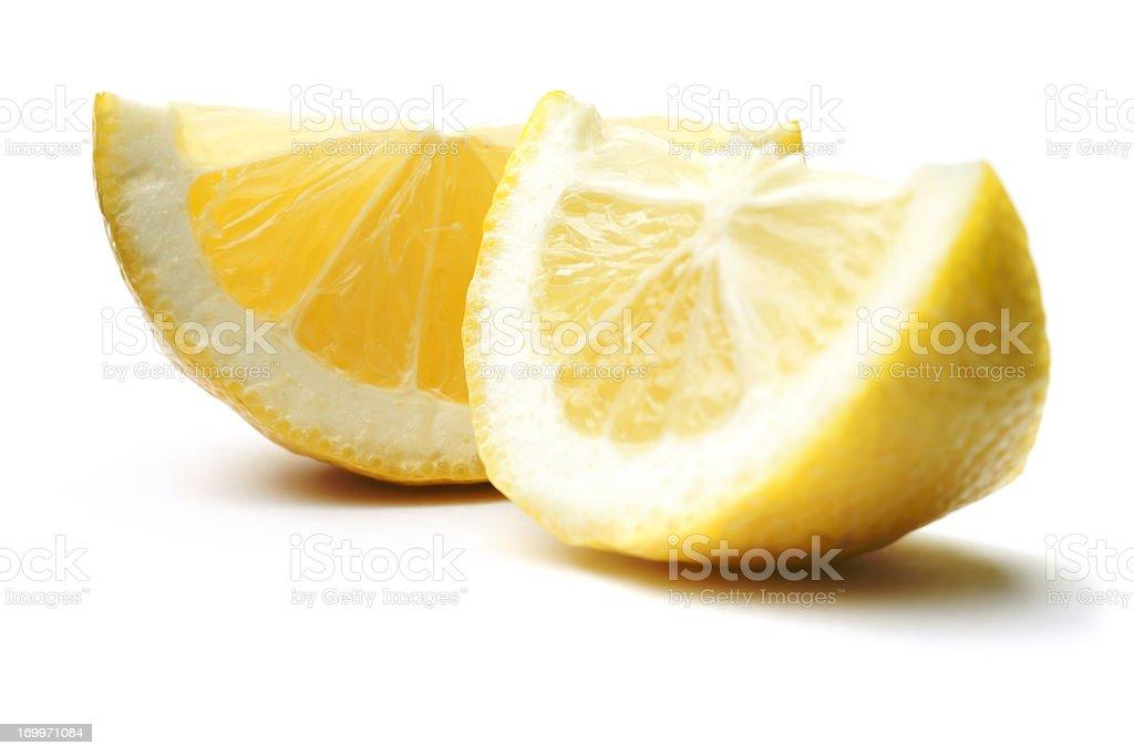 Lemon Wedges Isolated on White royalty-free stock photo