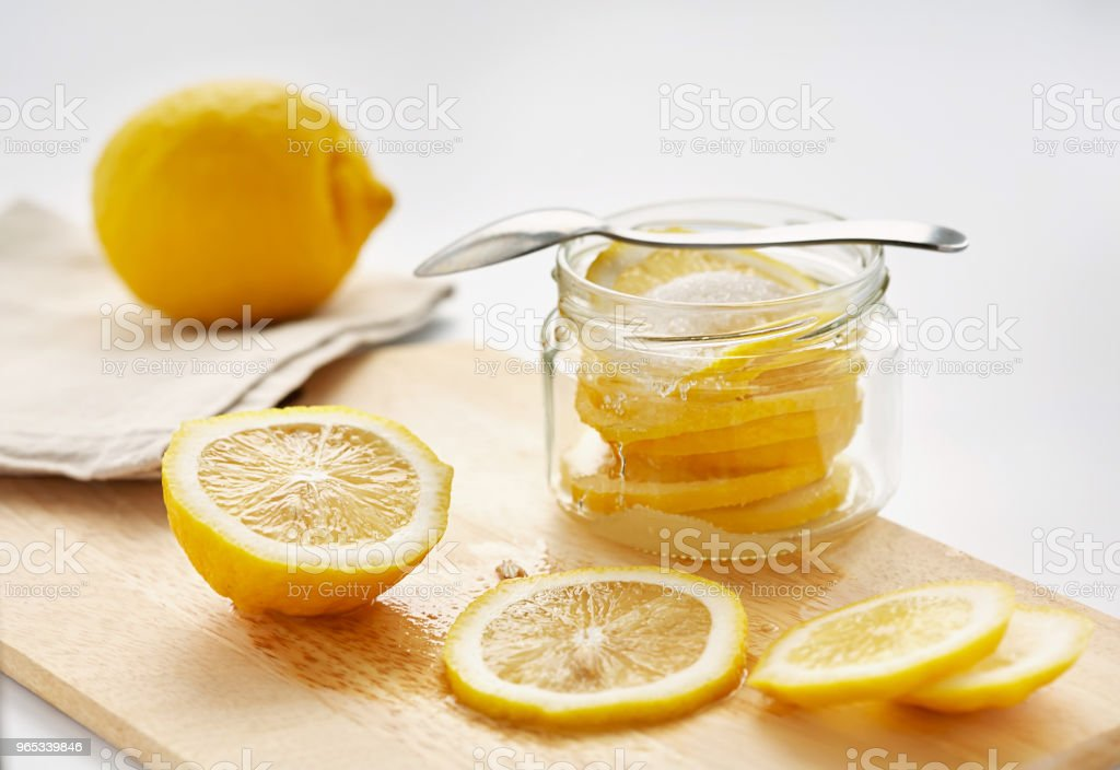 lemon with sugar is in a glass jar royalty-free stock photo