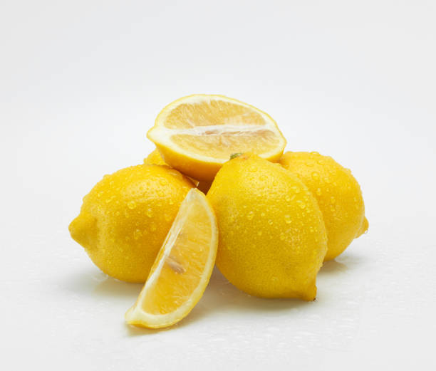 Lemon with water drops on white background