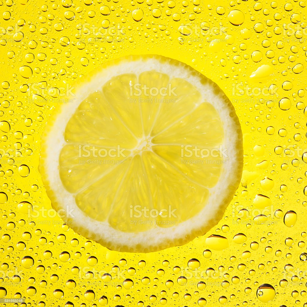 lemon with water drops stock photo