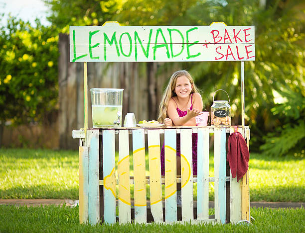 Lemonade and home baked cookies here Girl selling lemonade on stand lemonade stand stock pictures, royalty-free photos & images