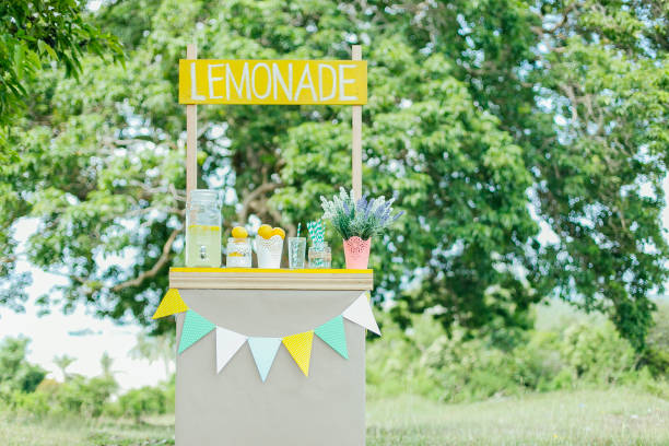 Lemonade for Sale Lemonade stall display during summertime. lemonade stand stock pictures, royalty-free photos & images