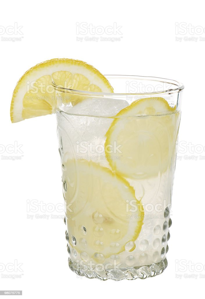 Lemonade In Antique Glass With Lemon Slices royalty-free stock photo