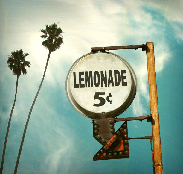lemonade sign aged and worn vintage lemonade sign with palm trees lemonade stand stock pictures, royalty-free photos & images