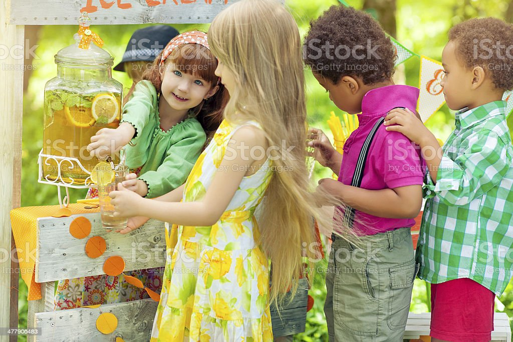 Lemonade stand and children royalty-free stock photo