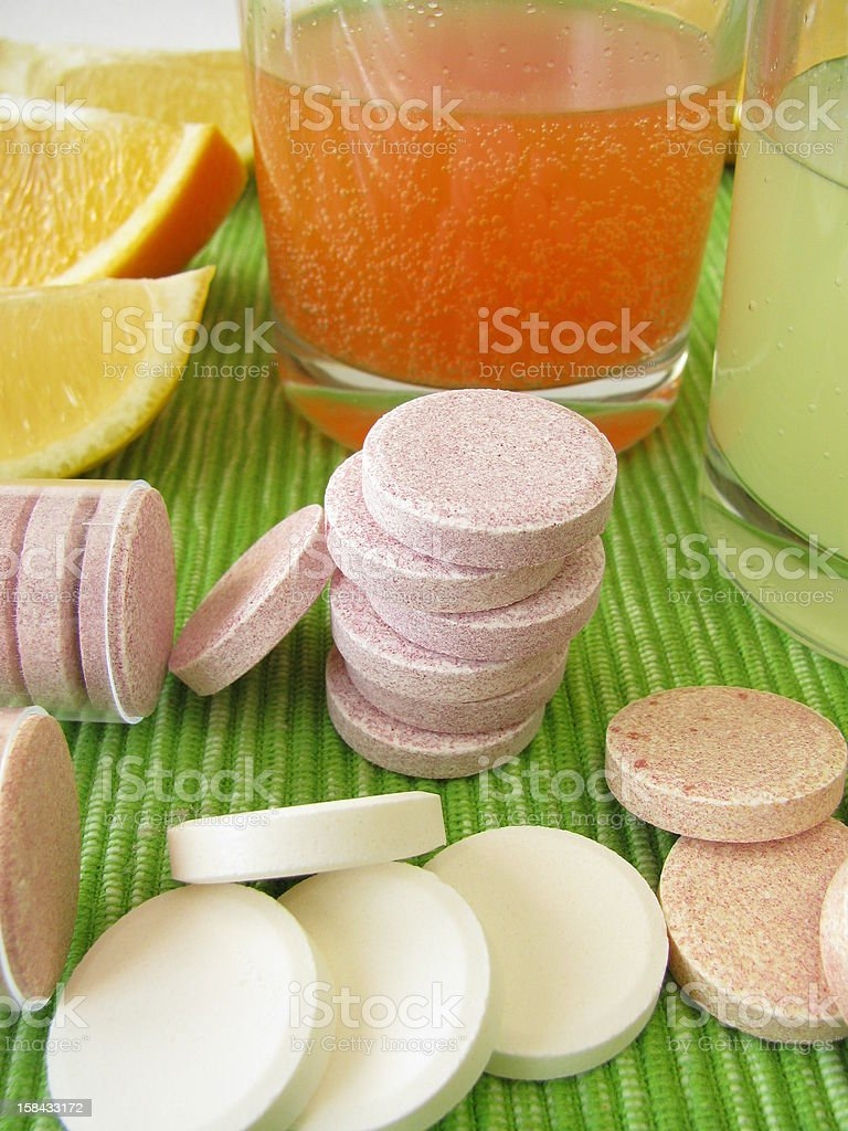 Lemonade tablets & vitamin tablets with oranges and juice stock photo