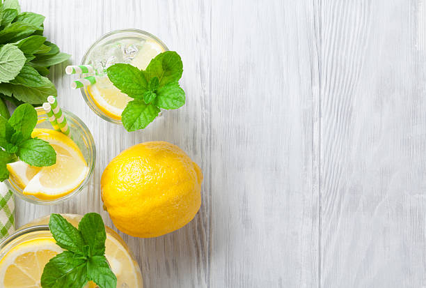 lemonade with lemon, mint and ice - limonade stock-fotos und bilder