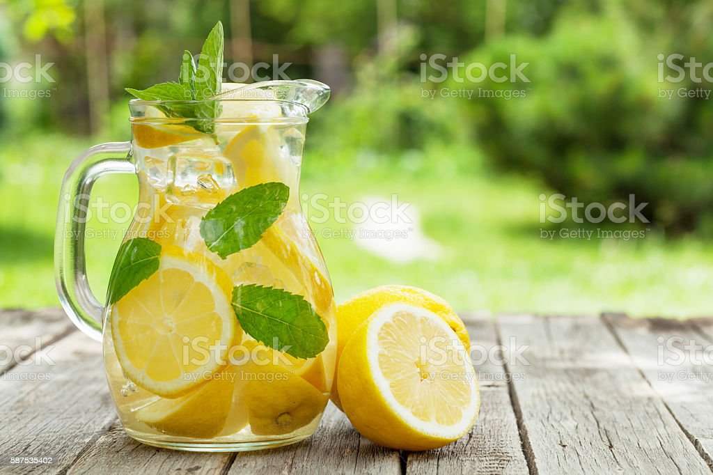 Lemonade with lemon, mint and ice stock photo