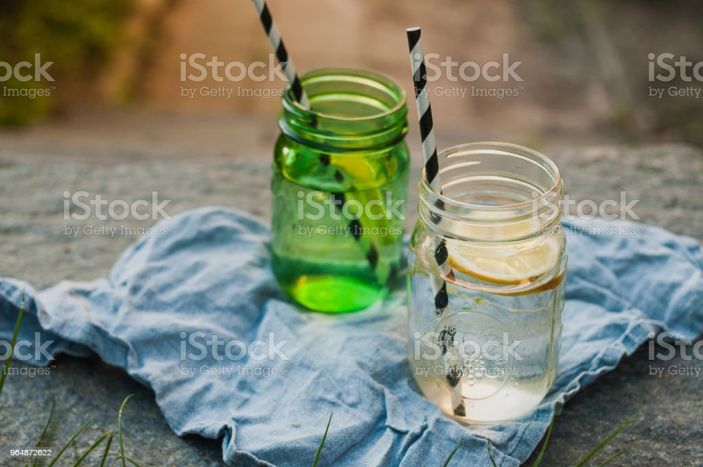 Lemonade with slices of lemon and hipster straws royalty-free stock photo