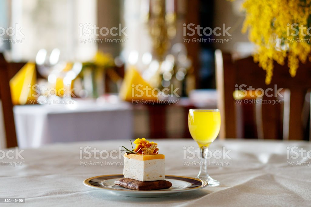 Lemoncello syrup with cake stock photo
