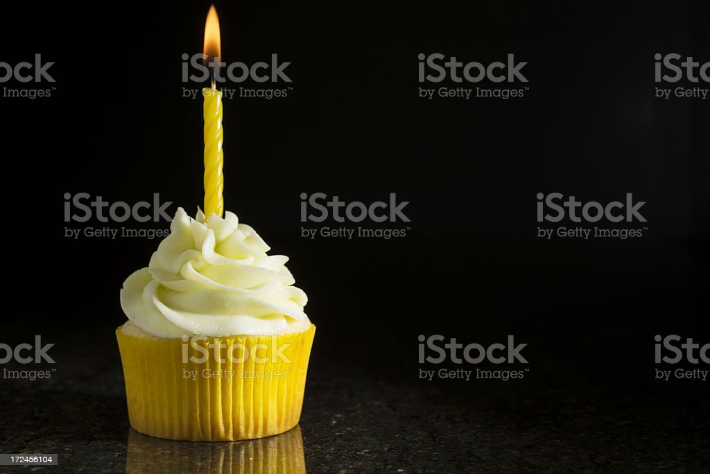 Lemon-Lime Cupcake with Candle on Black stock photo