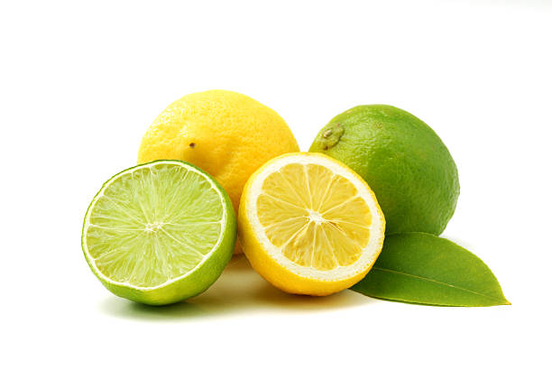 Lemons and green limes Close up of lemons and green limes isolated over white lime stock pictures, royalty-free photos & images