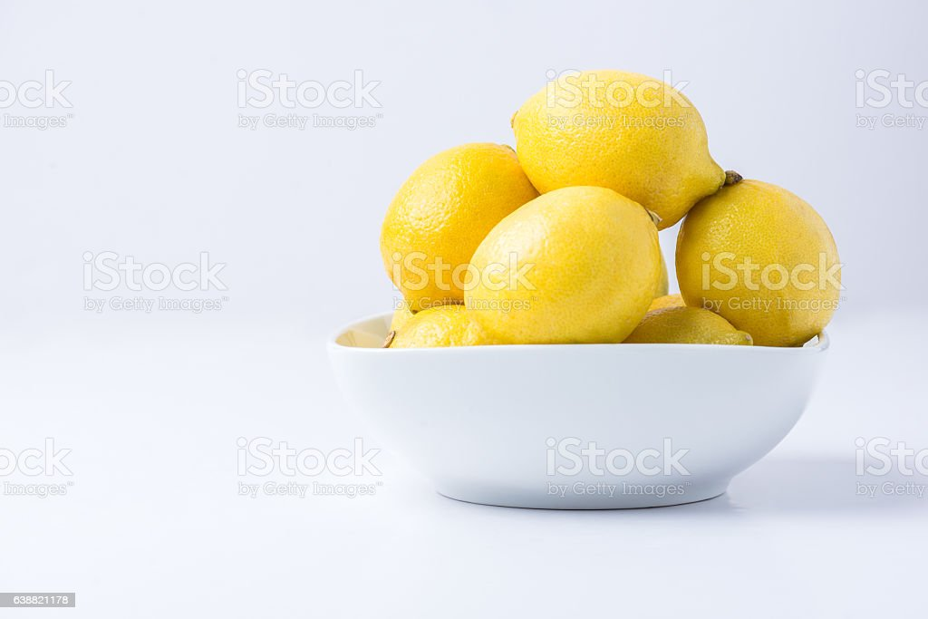 Lemons in a White Bowl stock photo