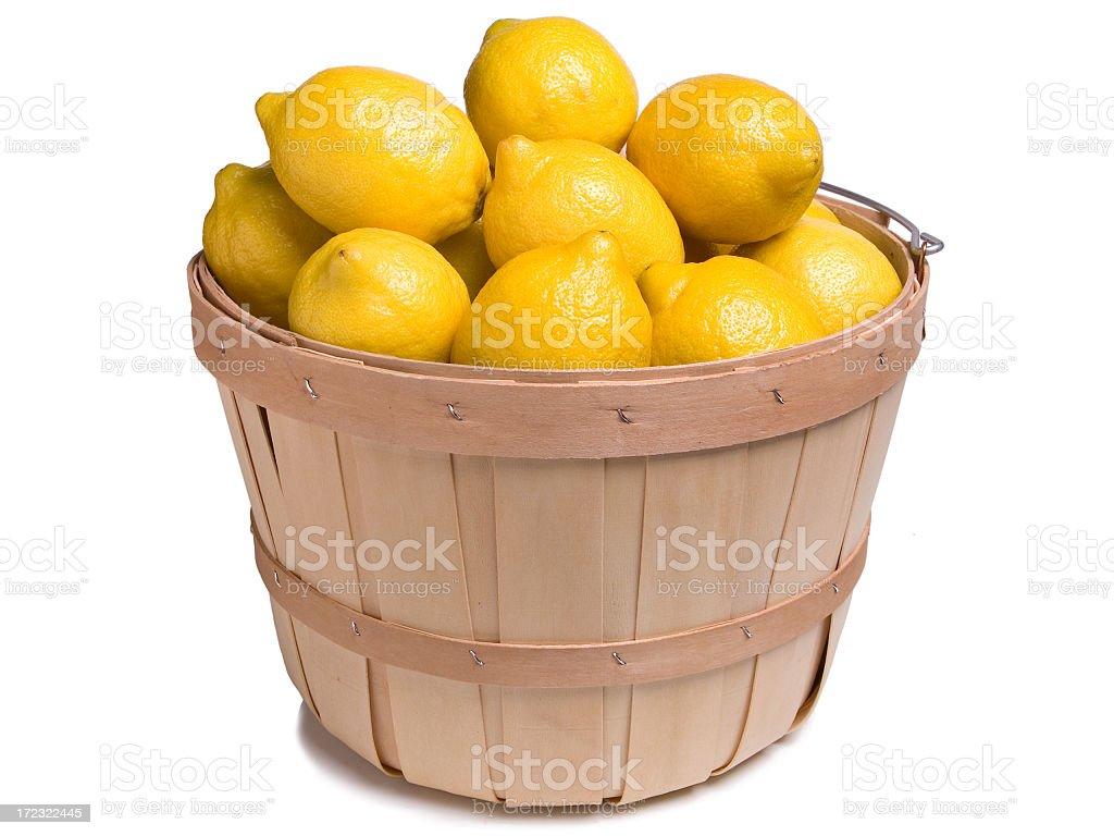 Lemons in a Wood Basket royalty-free stock photo