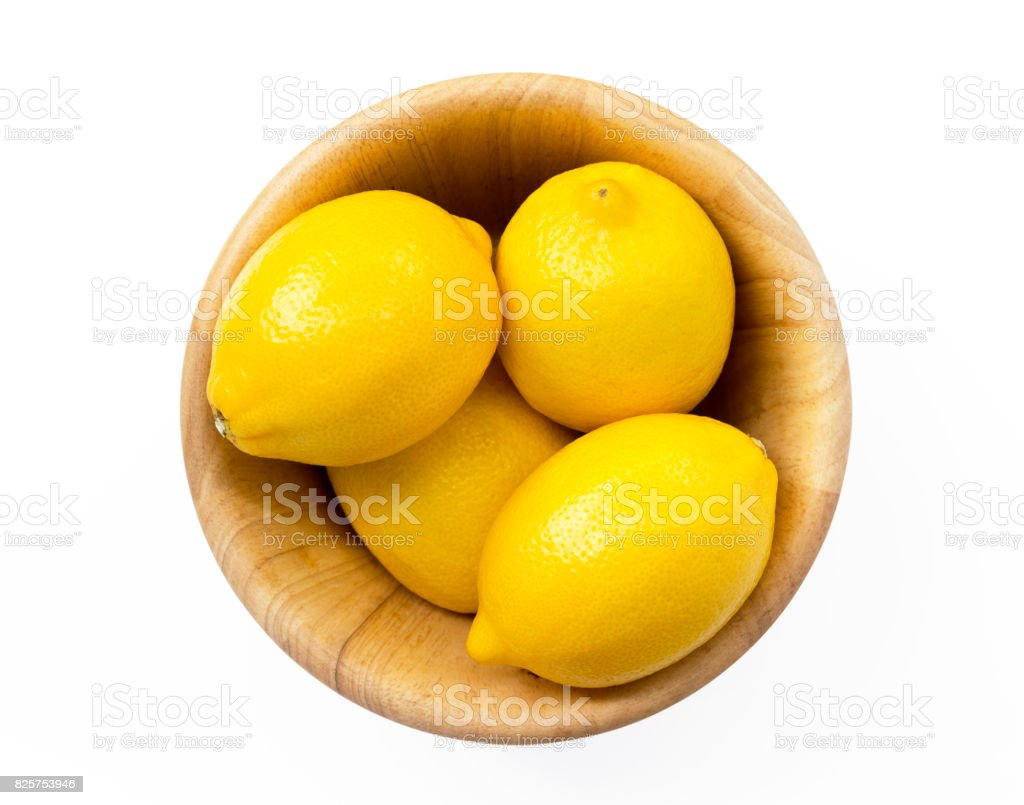 Lemons in wooden bowl isolated on white background. with clipping path. stock photo