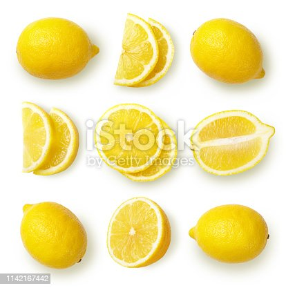Composition with whole and sliced lemons, cut out. Top view.