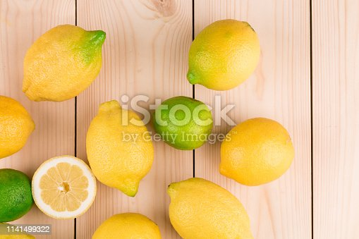 Lemons on the wooden floor. Close-up.