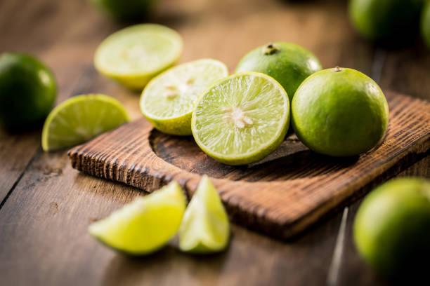 Lemons on wooden background stock photo