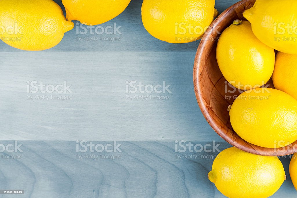 lemons on wooden table stock photo