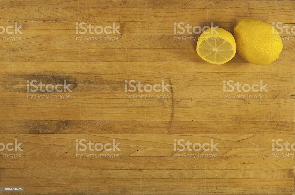 Lemons on Worn Butcher Block royalty-free stock photo