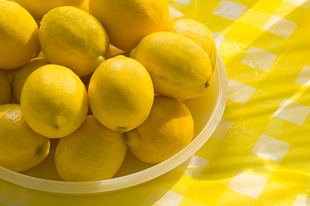 Lemons A stack of lemons at at lemonade standClick Here for More of this series: lemonade stand stock pictures, royalty-free photos & images