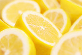 Lemons portions background. Shallow depth of field.Related pictures: