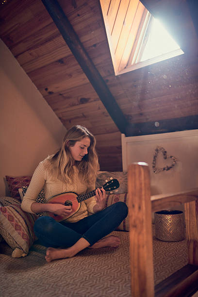 lend me your ear and i'll sing you a song - ukulele songs stock-fotos und bilder