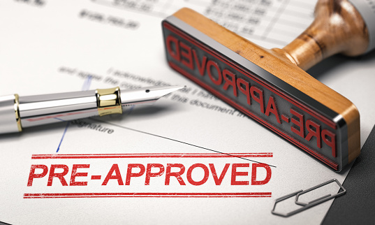Printed document with rubber stamp and the word pre-approved. Concept of mortgage or loan pre-approval. 3D illustration.