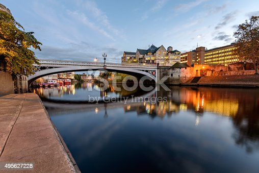 Relfection of Lendal bridge in still water of River Ouse, York, England.