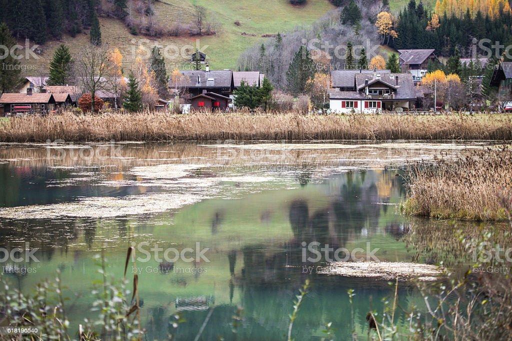 Lenkerseeli lake and Swiss houses in Lenk stock photo