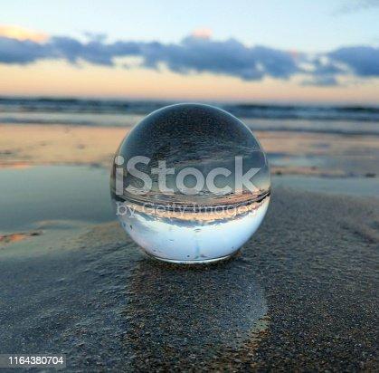 Sunset at Pentewan beach, Cornwall through a lens ball