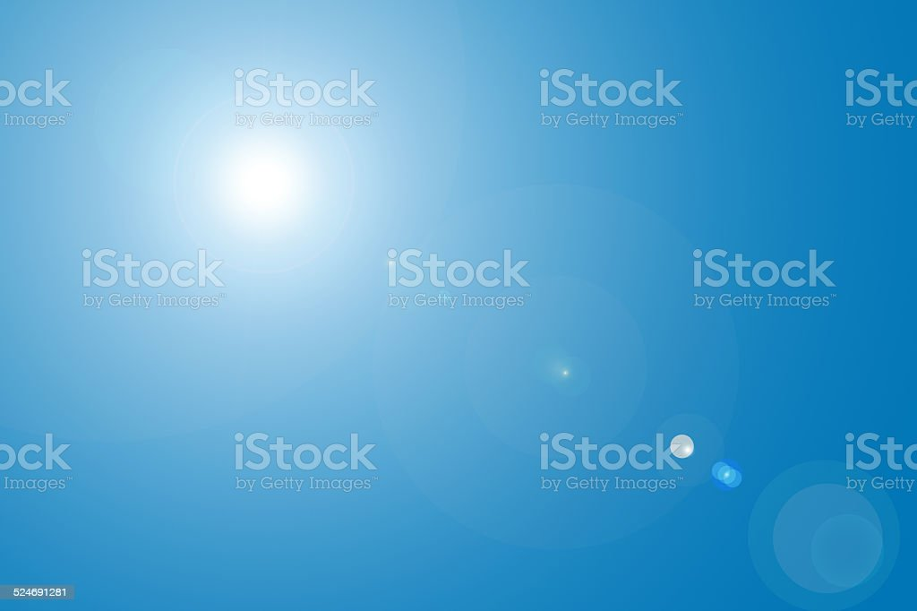 Lens flare in blue sky stock photo