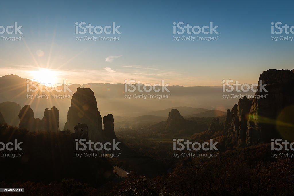Lens flare ower Meteora valley in Greece stock photo