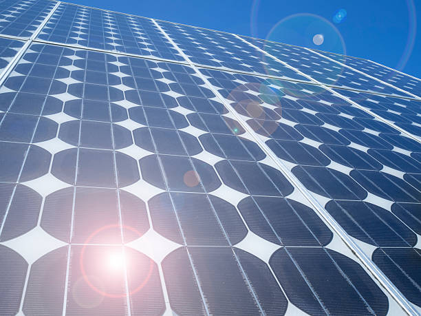 Lens flare solar panel photovoltaic cells stock photo