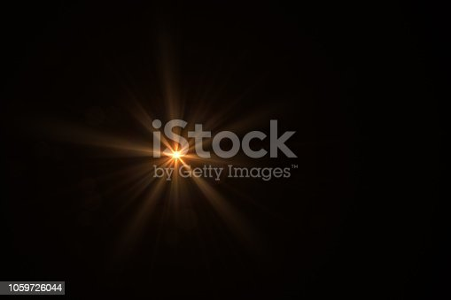 Lens Flare, Sun Light on Black Background, Solar Energy. Environmental Conversation.