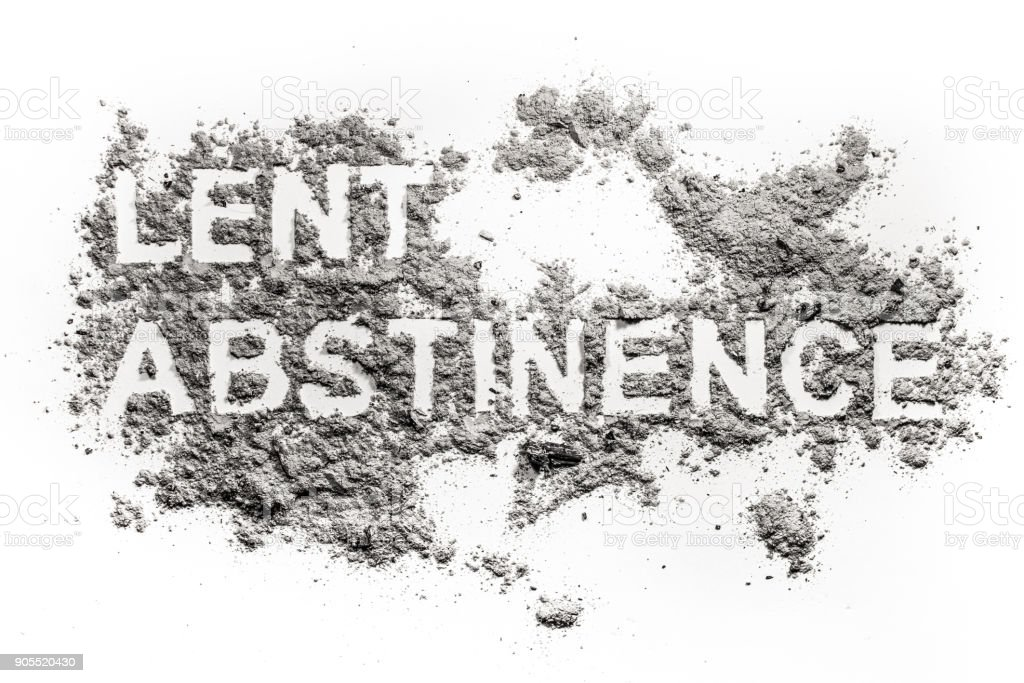 Lent abstinence word text written in ash, sand or dust stock photo