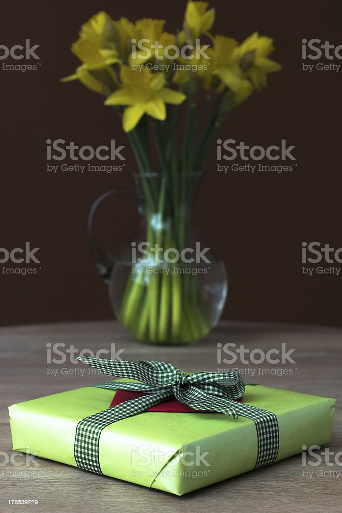 Lent lily daffodil in a glass vase with Easter gift stock photo