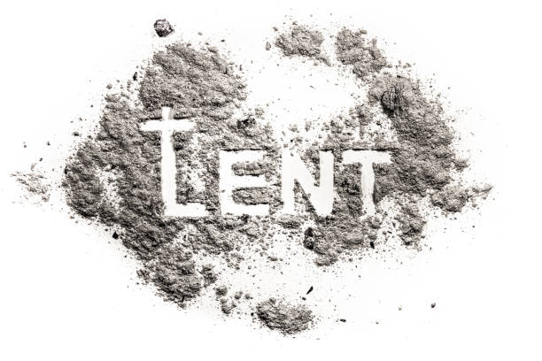lent word with cucifix drawing in ash, sand, dust - ash cross stock photos and pictures