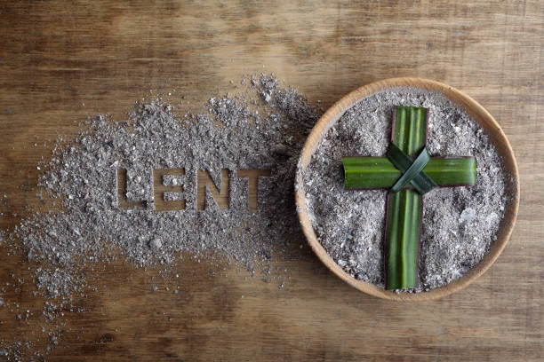 Lent word written in ash, dust as fast and abstinence period concept. Top view Lent word written in ash, dust as fast and abstinence period concept. lent stock pictures, royalty-free photos & images