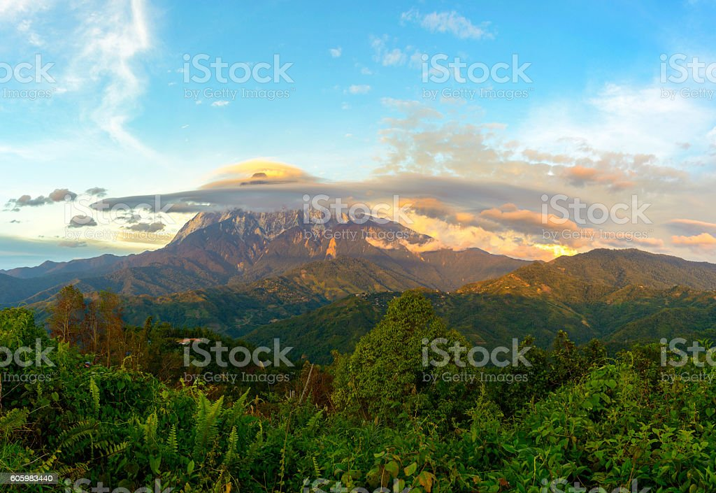 Lenticular clouds over Mount Kinabalu at sunset stock photo
