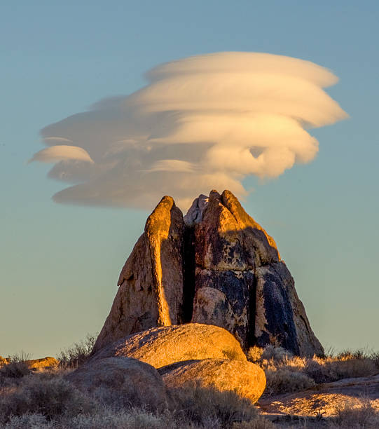 Lenticular Dome Lenticular cloud over a granite dome in the Eastern Sierra, California. lenticular cloud stock pictures, royalty-free photos & images