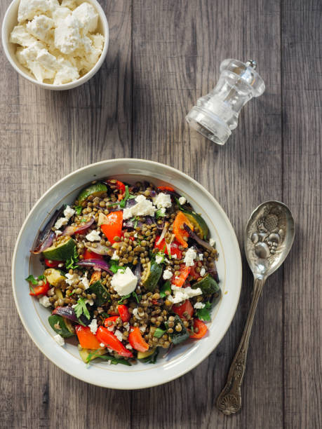 Lentil and roasted vegetable salad with feta cheese stock photo