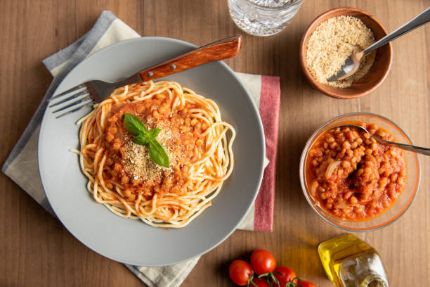 Lentil bolognese pasta. Vegan food stock photo