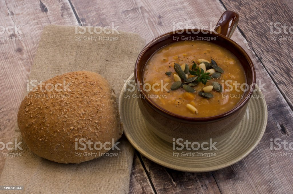 Lentil Soup with a bread roll stock photo