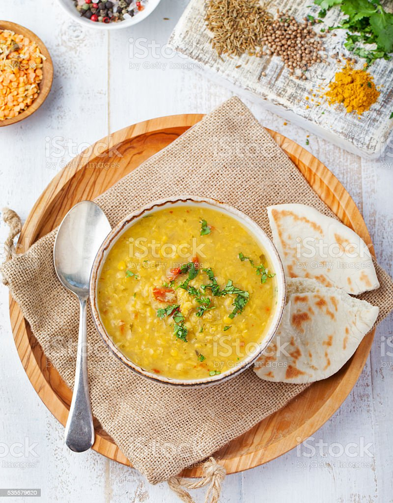 Lentil soup with bread in ceramic white bowl Top view stock photo