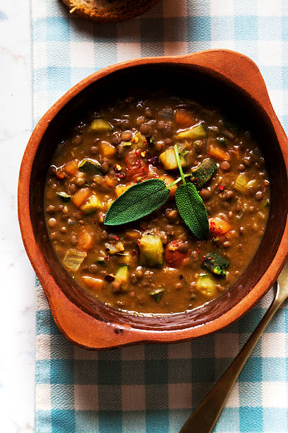 lentil Soup with Crusty Bread on the table stock photo