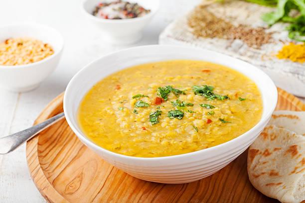 Lentil soup with pita bread in a ceramic white bowl stock photo