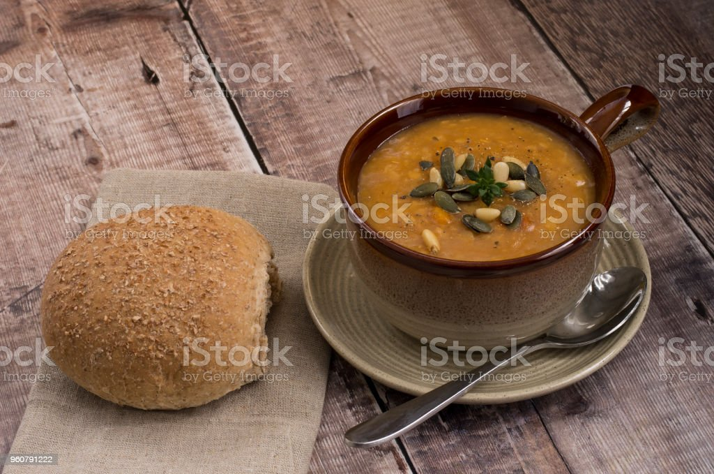 Lentil Soup with rustic roll and garnish stock photo